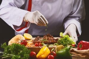 Gloved chef cooking restuarant